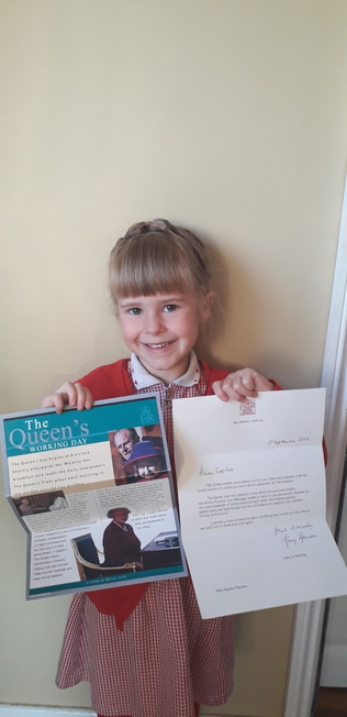 Sophie with her letter from the Queen.