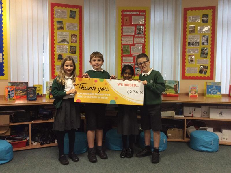 Some of our awesome Year 3s showing how much money we raised for Children in Need.