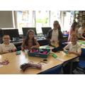 Decorating our felt butterflies