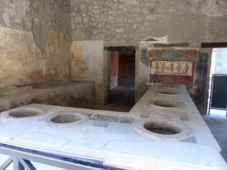 Thermopolium - the holes were used for refreshment