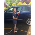 Mia does the car wash