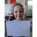 Emma has been working hard on her handwriting