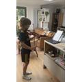 Sasha practices his violin