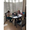 Siblings working hard!