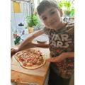 Thomas makes pizza