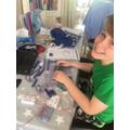 Aidan does elecrical circuits