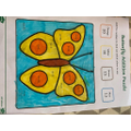 Autumn solved the sums to colour in the butterfly