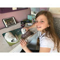 Izzy makes a dragon from air dried clay