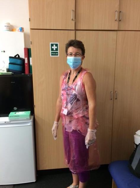 Mrs Williams wearing a mask and apron