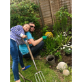 Mia helps in the garden