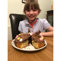 Hannah has the first slice of her chocclate creation