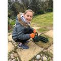 Mia does gardening.
