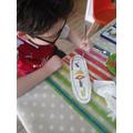 Serkan paints  a cartouche