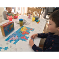 Samuel working hard on his puzzle