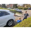 Matus cleans the car