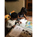 Menaal and Taha busy learning at home..JPG