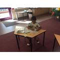 Ayaan practising writing his letters.jpg