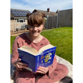 Mrs Credland reading again in her garden.