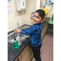 Bneamin washing his hands.jpg