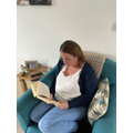 Mrs Tivey enjoying a relaxing read of her book