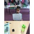 Haider writing a sentence.jpg