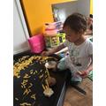 Reina playing with pasta and playdough