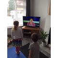 Mrs Ablewhite's children doing their morning exercise..j