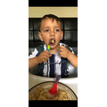 Huzaifa feeds himself for the first time.