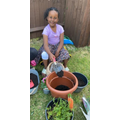 Hafsa doing some gardening.