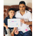 Ayyan from Class1 gives a Father's Day certificate