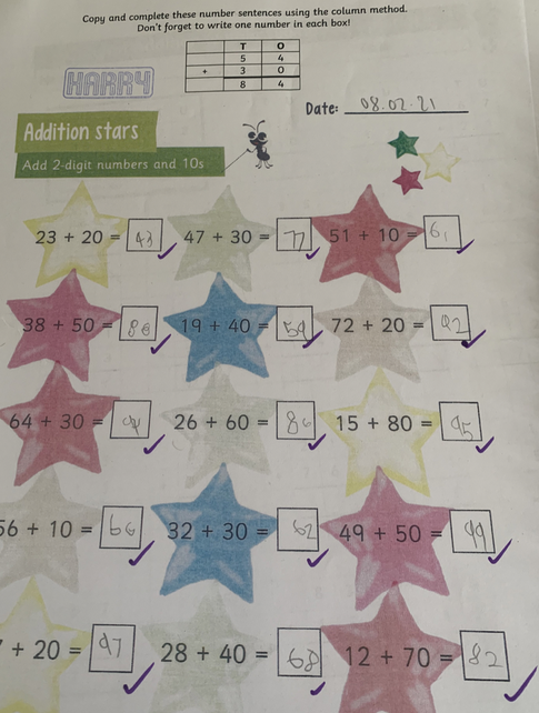 Year 2 using column addition to solve addition problems with two 2-digit numbers