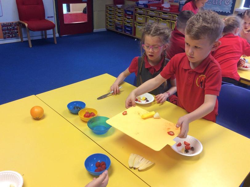 Y2 create healthy  fruit salad.Yes we grew it!!