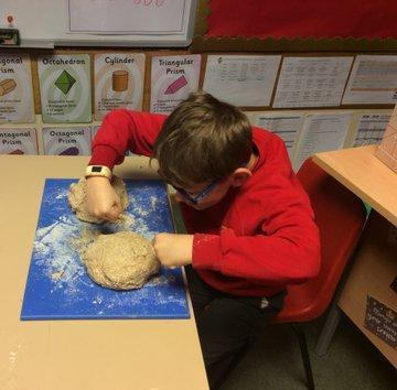 Y3/4 made stone age bread and modern day bread