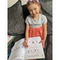 A working hard on her home learning.