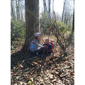 A and her brother building dens in the wood.