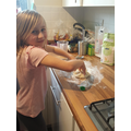 I.W helping her sister making flatbreads.