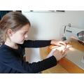 N.Q practising her sewing skills.