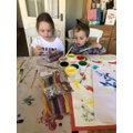 T and her brother making colourful Easter bags