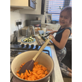 A is cooking for her family.