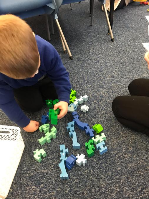 Using the jigsaws to practise ordering numbers.