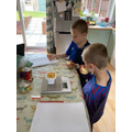 Finley and his brother weighing food items.