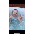 Isla- Mae celebrating VE Day in the hot tub!