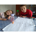 Arlo and his sister working together