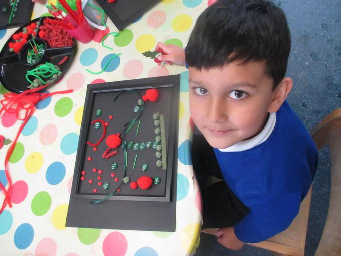 The children had a go at making poppy pictures using different loose objects.
