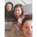 Miss Markland and her children enjoying a movie.