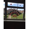 A rainbow of hearts on Hattie's window.