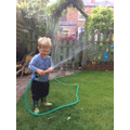 Arthur loves the hosepipe-look how soggy he is!