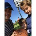 The Kowalskis are enjoying playing basketball