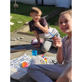 Will and Holly have been painting outside.