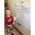 Finley completing a maths challenge